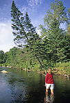 Woman fly fishing in Baxter State Park, Maine, USA