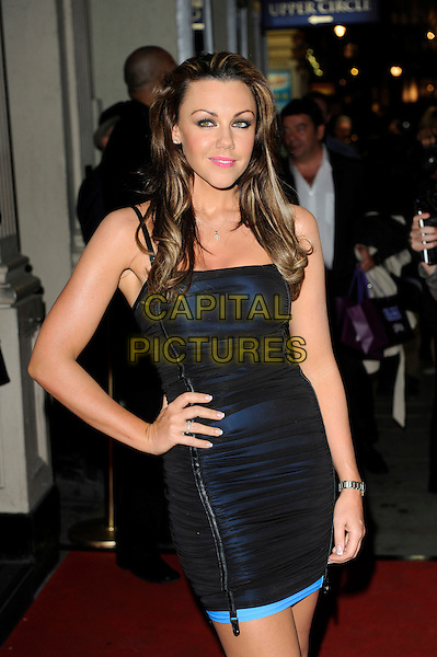 MICHELLE HEATON.Reveal - 5th birthday party, MO*VIDA, London, England. .October 20th 2009.movida half length black blue ruched dress hand on hip zip zipper .CAP/CJ.©Chris Joseph/Capital Pictures.