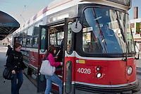 Transit riders get in a TTC streetcar April 19, 2010. The Toronto streetcar system is operated by the Toronto Transit Commission (TTC), the municipal public transit operator.