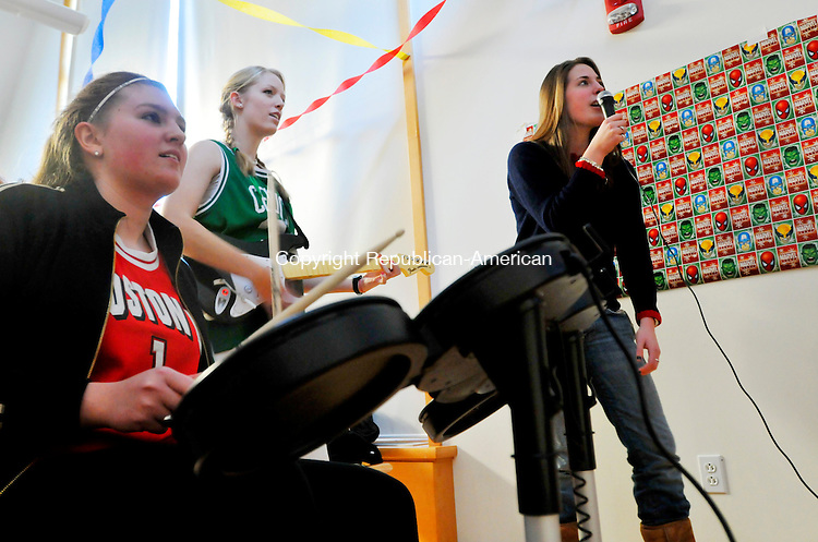 MIDDLEBURY, CT- 11 JANUARY 2008 --011109JS04-FOR COUNTRY LIFE-Westover students, Molly Sheehan of Woodbury, left, Jenna Littmann of Rocky Hill, center, along with Westover graduate Kendall Mulligan of Southbury, play Rock Band during the annual Dorcas Fair held Sunday at the Westover School, The event, now in its 100th year, is a fundraiser organized by the junior class. Money raised from the event is donated to charitable groups.<br /> Jim Shannon / Republican-American