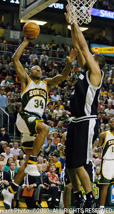 Seattle SuperSonics' Ray Allen,L, goes up to score two of his 17 points in the first half of their  Western Conference Semifinals Game 4 against the San Antonio Spurs in Seattle, Washington on Sunday, 15 May 2005. Defending on the play is San Antonio Spurs' Tim Duncan, who had 20 points.  Jim Bryant Photo. ©2010. All Rights Reserved.