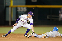 LSU Tiger second baseman JaCoby Jones (23) attempts to tag the UCLA baserunner during Game 4 of the 2013 Men's College World Series against the UCLA Bruins on June 16, 2013 at TD Ameritrade Park in Omaha, Nebraska. UCLA defeated LSU 2-1. (Andrew Woolley/Four Seam Images)