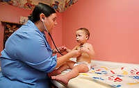 MARIANNA, FLA. 9/15/09-FSUMED SAUTER CH05-Amanda Sautter, a third-year student with the Florida State College of Medicine, left, examines with Galaxy Pszczola, age 18 months, at the office of Dr. Doyle Bosse, clerkship faculty-rural track in Marianna...COLIN HACKLEY PHOTO