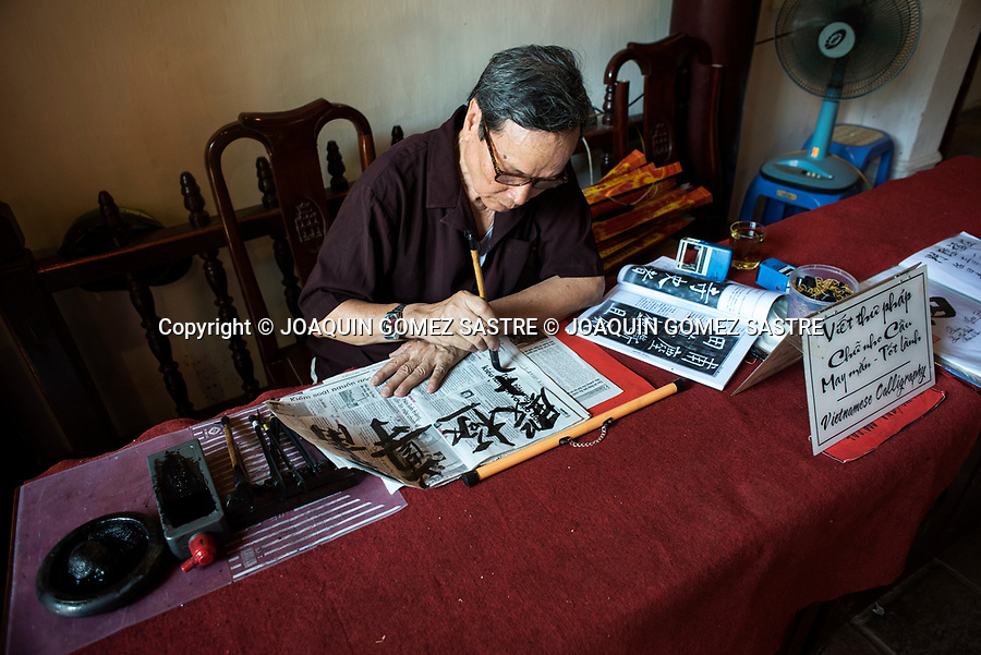 A man practices Vietnamese calligraphy in the city of Hanoi in the north of Vietnam<br /> HANOI-VIETNAM
