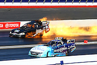 Feb 8, 2015; Pomona, CA, USA; NHRA funny car driver Jeff Arend explodes a fuel tank causing a fire alongside Tommy Johnson Jr during the Winternationals at Auto Club Raceway at Pomona. Arend was uninjured in the explosion. Mandatory Credit: Mark J. Rebilas-USA TODAY Sports