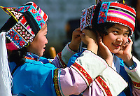 Young girls wearing traditional costume in Kunming, China RESERVED USE - NOT FOR DOWNLOAD -  FOR USE CONTACT TIM GRAHAM
