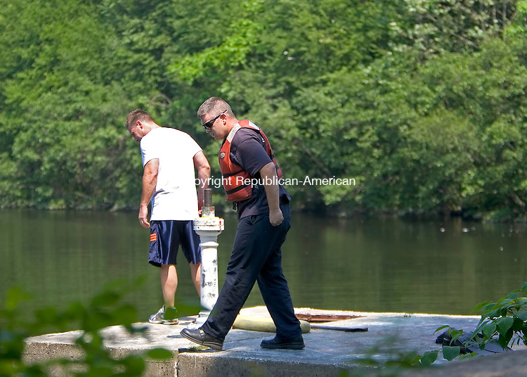 WATERBURY, CT-- 10 June 2008--061008BF02- Members of the Waterbury Fire Department search for a missing teenager's body in the water behind the Mill Plain Union Church on Southmayd Road in Waterbury Tuesday afternoon.  A group of boys were swimming in the area when the reported drowning happened. Bob Falcetti Republican-American