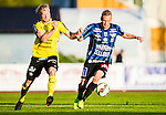 ***BETALBILD***  <br /> Uppsala 2015-05-21 Fotboll Superettan IK Sirius - Mj&auml;llby AIF :  <br /> Sirius Christer Gustafsson i kamp om bollen med Mj&auml;llbys Robin Cederberg under matchen mellan IK Sirius och Mj&auml;llby AIF <br /> (Foto: Kenta J&ouml;nsson) Nyckelord:  Superettan Sirius IKS Mj&auml;llby AIF