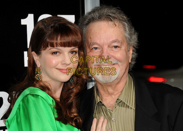 """AMBER & RUSS TAMBLYN .""""127 Hours"""" Los Angeles Premiere held at the AMPAS Samuel Goldwyn Theater, Beverly Hills, California, USA..November 3rd, 2010.headshot portrait dress beige gold shirt black goatee facial hair father dad daughter family green silk satin dangling gold earrings fringe bangs hair .CAP/ADM/BP.©Byron Purvis/AdMedia/Capital Pictures."""