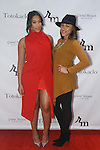 Keisha Sullivan (left) and Janay Rice attend the 3rd Annual Wives' Holiday Soiree at Totokaelo in SOHO on December 9, 2015.