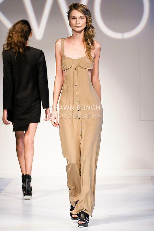 Model walks the runway in an outfit by Nicole Kwon, for the NKWON Spring 2011 fashion show, during Nolcha Fashion Week, September 13, 2010.