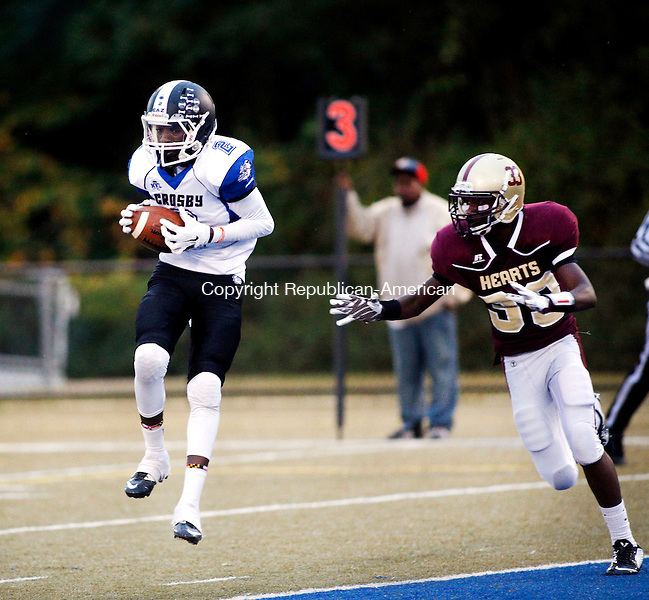 Waterbury, CT- 01 October 2015-100115CM06-  Crosby's Eli Mbaya makes the catch for the touchdown against Sacred Heart's Jordan Robinson during their NVL matchup in Waterbury on Thursday.    Christopher Massa Republican-American
