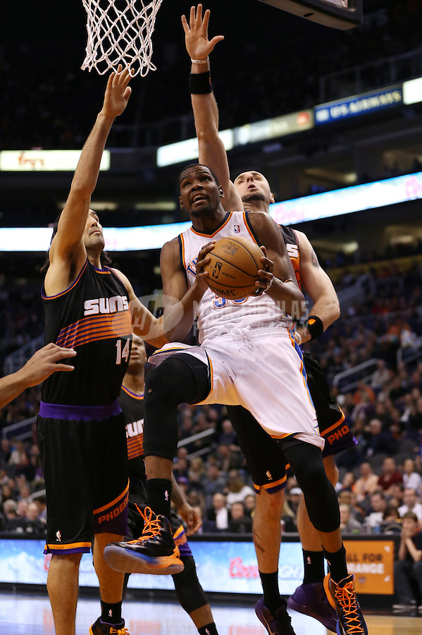 Feb. 10, 2013; Phoenix, AZ, USA: Oklahoma City Thunder forward Kevin Durant (35) drives to the basket against the Phoenix Suns in the first quarter at the US Airways Center. Mandatory Credit: Mark J. Rebilas-
