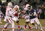 Nevada's Lenny Jones (94) pressures Fresno State quarterback Brian Burrell (2) during the second half of an NCAA college football game in Reno, Nev., on Saturday, Nov. 22, 2014. Fresno State's Cody Wichmann (73) and Justin Northern (54) were also in on the play. (AP Photo/Cathleen Allison)