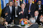 (Left to right) United States President Barack Obama, United Nations Secretary-General Ban Ki-moon and President Vladimir Putin of Russia join other world leaders and ambassadors in a toast during a luncheon hosted by Ki-moon during the 70th annual UN General Assembly at the UN headquarters September 28, 2015 in New York City. Obama held a bilateral meeting with Indian Prime Minister Narendra Modi and will have a face-to-face meeting with Russian President Vladimir Putin later in the day. <br /> Credit: Chip Somodevilla / Pool via CNP