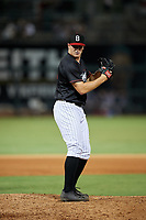 Birmingham Barons relief pitcher Brian Clark (25) delivers a pitch during a game against the Tennessee Smokies on August 16, 2018 at Regions FIeld in Birmingham, Alabama.  Tennessee defeated Birmingham 11-1.  (Mike Janes/Four Seam Images)
