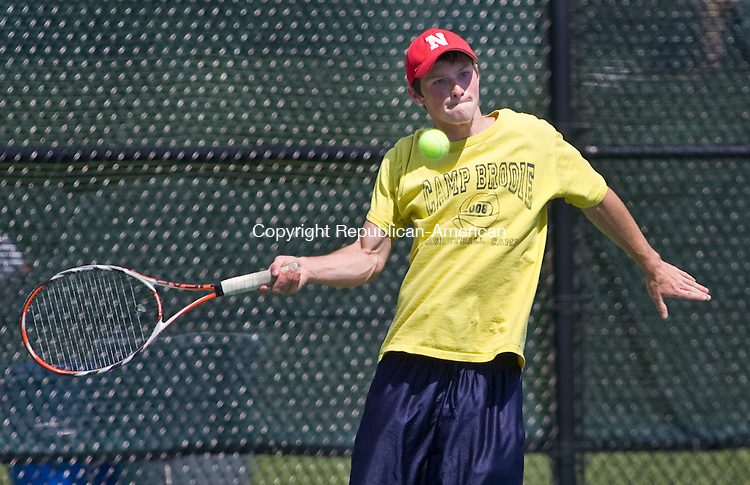 LAKEVILLE, CT - 21 MAY 2010 -052110JT07-<br /> Northwestern's Connor Pickett returns the ball to Shepaug's Tom Andrews during Friday's Berkshire League Tennis Championship at the Hotchkiss School in Lakeville.<br /> Josalee Thrift Republican-American