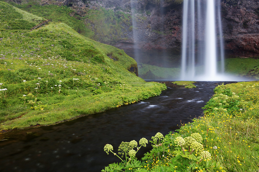 Seljalands River flows from base of Seljalandsfoss waterfall, South Region, Iceland