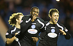 Kilmarnock v St Johnstone....15.01.11  .Cleveland Taylor celebrates his goal with Murray Davidson, the sucking of the thumb is to mark the bith of his daughter Ava who was born on Thursday 13th Jan..Picture by Graeme Hart..Copyright Perthshire Picture Agency.Tel: 01738 623350  Mobile: 07990 594431