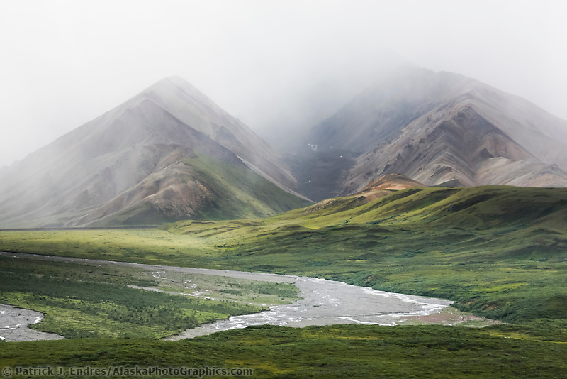 Dramatic and stormy clouds over the drainages flowing out of the Polychrome mountains of Denali National Park, Interior, Alaska.