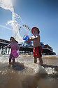 17/06/14 <br /> <br /> Cooling off on the hottest day of the year, Joshua Davies (4) and his sister, Skye (2), play in the sea by Blackpool pier.<br /> <br /> All Rights Reserved - F Stop Press.  www.fstoppress.com. Tel: +44 (0)1335 300098