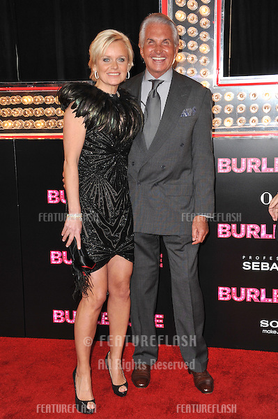 "George Hamilton & Barbara Sturm at the Los Angeles premiere of ""Burlesque"" at Grauman's Chinese Theatre, Hollywood..November 15, 2010  Los Angeles, CA.Picture: Paul Smith / Featureflash"