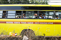 Vasudha Vidya Vihar students on board their bus to school in Maheshwar, Khargone, Madhya Pradesh, India on 13 November 2014. The Vasudha Vidya Vihar school was built using the Fairtrade Premium and has a fleet of school busses also bought using Fairtrade Premiums. Fairtrade farmers get a 5% discount on the fees. Photo by Suzanne Lee for Fairtrade