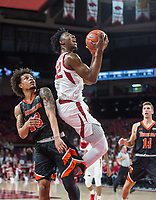 NWA Democrat-Gazette/BEN GOFF @NWABENGOFF <br /> Gabe Osabuohien of Arkansas shoots as Austin Hall Tusculum defends in the first half Friday, Oct. 26, 2018, during an exhibition game in Bud Walton Arena in Fayetteville.