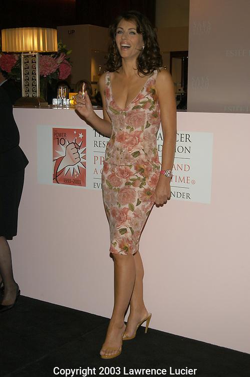 Elizabeth Hurley wearing a Dolce&Gabbana dress.