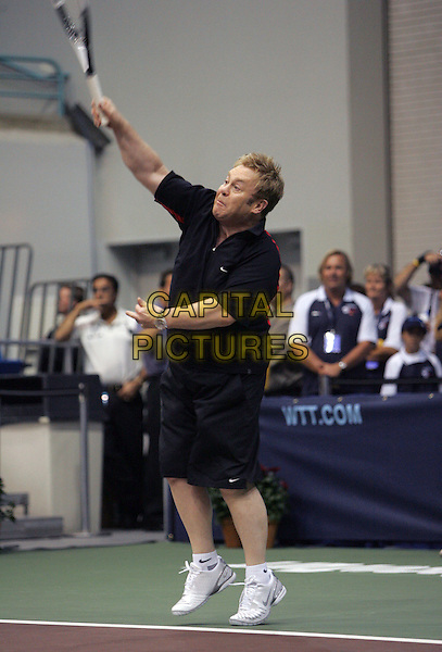 ELTON JOHN.The 14th Annual Advanta WTT Smash Hits held at The UC Irvince Bren Center in Irvine, California, USA..September 14th, 2006.Ref: DVS.full length black shorts racket tennis sport jumping.www.capitalpictures.com.sales@capitalpictures.com.©Debbie VanStory/Capital Pictures