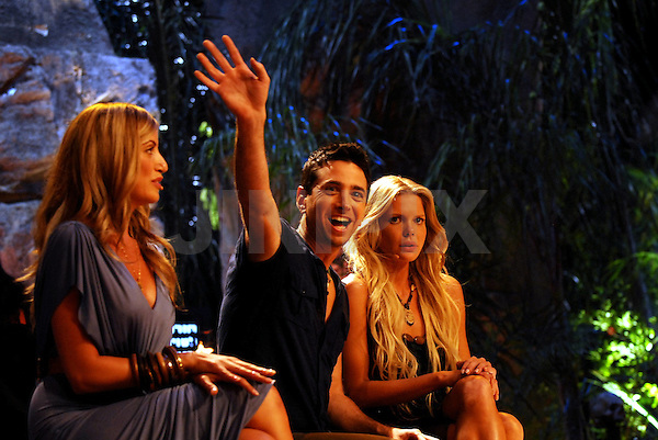 """The final three """"Survivor Israel"""" contestants, Mirit Vaknin (L), Arik Alfer (C) and Neta-Li Zeltzerman (R) are seen on stage in the amphitheatre in Caesarea, during the final episode of the second season of the popular reality TV show of Survivor, Saturday evening, May 23, 2009. The Pediatrician Arik Alfer, ended up taking the title """"last survivor"""", and winning a prize worth a million NIS. Photo By: Tomer Neuberg / JINI."""