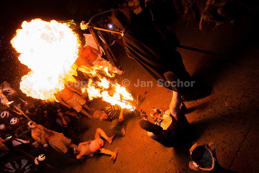 A young Salvadoran man, lying on the back, spits fire as he performs during the La Calabiuza parade at the Day of the dead celebration in Tonacatepeque, El Salvador, 1 November 2016. The festival, known as La Calabiuza since the 90s of the last century, joins Salvador's pre-Hispanic heritage and the mythological figures (La Sihuanaba, El Cipitío, La Llorona etc.) collected from the whole Central American region, together with the catholic All Saints Day holiday and its tradition of honoring the dead relatives. Children and youths only, dressed up in scary costumes and carrying painted carts, march from the local cemetery to the downtown plaza where the party culminates with music, dance, drinking and eating pumpkin (Ayote) with honey.