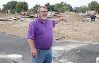 NWA Democrat-Gazette/DAVID GOTTSCHALK Mike Gilbert, chief operating officer of the Jones Trust, describes different features Tuesday, October 9, 2018, of the Runway Bicycle Skills Park at the Jones Center in Springdale. The park will host the Pump Track (bicycling) World Championships sponsored by Red Bull on Saturday, October 13. A pump track is designed so that bikers pump and push on hills and turns to build speed using their upper body and hips instead of pedaling.