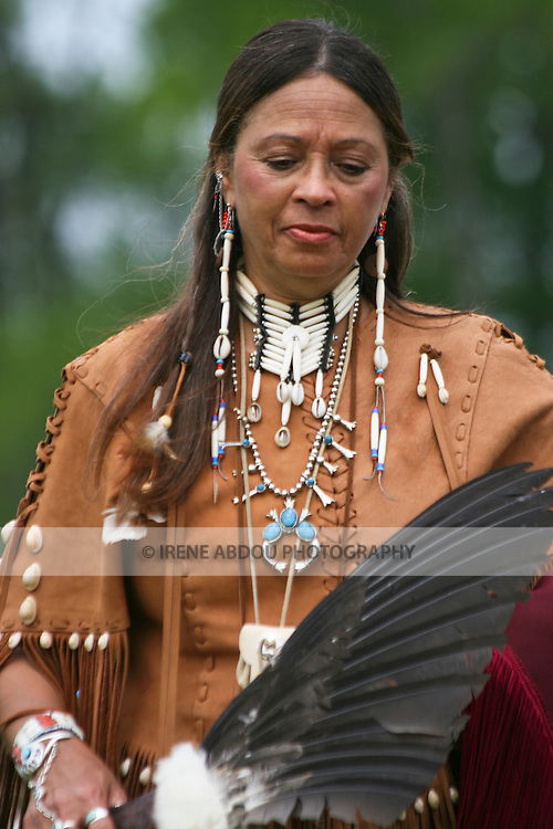 A Native American woman dances at the 8th Annual Red Wing PowWow in Red Wing Park, Virginia Beach, Virginia.