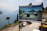 Switzerland. Canton Ticino. Lugano. Castagnola area. Real estate billboard. Construction of private houses on a deluxe standing. View on the lake Lugano ( alos called Lago Ceresio). For sale. 2.06.12 © 2012 Didier Ruef