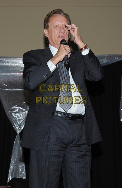 Actor James Woods attends 'A Conversation With James Woods' presented by CARSTAR Automotive Canada Inc. in support of Cystic Fibrosis Canada at Carmen's Banquet and Convention Centre, Hamilton, Ontario, Canada..November 20th, 2011.half length black suit grey gray tie white shirt microphone  hand   .CAP/ADM/BPC.©Brent Perniac/AdMedia/Capital Pictures.