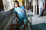A disabled teenage boy sits in the Agent Orange children's ward of Tu Du Hospital in Ho Chi Minh City, Vietnam.  About 500 of the 60,000 children born each year at the maternity hospital, Vietnam's largest, are born with deformities, some because of Agent Orange. About 60 of them currently live on the ward, ranging in age from newborns to young people in their 30s. May 1, 2013.