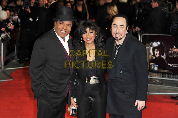 "Toriano Adaryll ""Tito"" Jackson, Rebbie Jackson & David Gest .The ""Michael Jackson : The Life Of An Icon"" UK premiere, Empire cinema, Leicester Square, London, England..2nd November 2011.half length top jacket black suit hat white shirt beard facial hair smiling necklaces cross crucifix family brother sister .CAP/MAR.© Martin Harris/Capital Pictures."
