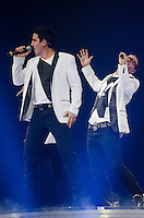 Jonathan Knight and Donnie Wahlberg of New Kids on The Block perform at BB&T Center during The Package Tour 2013, Sunrise, Florida, June 22, 2013