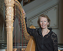 London, UK. 12.03.2015. Alison Martin, Harpist with ENO Orchestra, at the London Coliseum. Photograph © Jane Hobson.