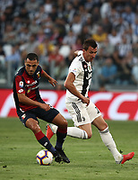 Calcio, Serie A: Juventus - Genoa, Turin, Allianz Stadium, October 20, 2018.<br /> Genoa's Romulo (l) in action with Juventus' Mario Mandzukic (r) during the Italian Serie A football match between Juventus and Genoa at Torino's Allianz stadium, October 20, 2018.<br /> UPDATE IMAGES PRESS/Isabella Bonotto