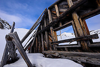 An abandoned cabin wall provides a frame of the Talkeetna Mountains in Hatcher Pass neaar Palmer, Alaska.