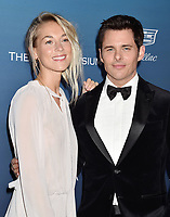 LOS ANGELES, CA - JANUARY 05: Emma Deigman (L) and James Marsden attend Michael Muller's HEAVEN, presented by The Art of Elysium at a private venue on January 5, 2019 in Los Angeles, California.<br /> CAP/ROT/TM<br /> ©TM/ROT/Capital Pictures
