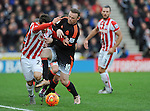 Wayne Rooney of Manchester United is challenged by Bojan Krkic of Stoke City<br /> - Barclays Premier League - Stoke City vs Manchester United - Britannia Stadium - Stoke on Trent - England - 26th December 2015 - Pic Robin Parker/Sportimage