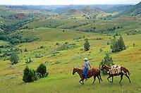 Cowboy with packhorse, riding in Badlands near Medora, North Dakota, AGPix_0324.