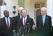 United States Senator Pat Toomey (Republican of Pennsylvania) makes a statement to reporters after he and other members of the US Senate Finance Committee had lunch with US President Donald J. Trump at the White House in Washington, DC on Monday, November 27, 2017. From left to right behind Toomey: US Senator Tim Scott (Republican of South Carolina), US Senator John Cornyn (Republican of Texas) and US Senator Orrin Hatch (Republican of Utah).<br /> Credit: Ron Sachs / CNP