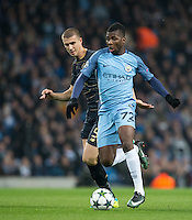 Kelechi Iheanacho of Manchester City heads away from Jozo Simunovic of Celtic during the UEFA Champions League GROUP match between Manchester City and Celtic at the Etihad Stadium, Manchester, England on 6 December 2016. Photo by Andy Rowland.
