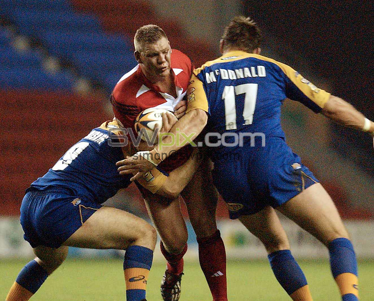 Pix: Oskar Vierod/SWpix.com. Super League Rugby. Wigan v Leeds. 20/09/2002...COPYRIGHT PICTURE>>SIMON WILKINSON>>01943 436649>>..Wigan's Danny Tickle  and Leeds Wayne McDonald and Matt Diskin..