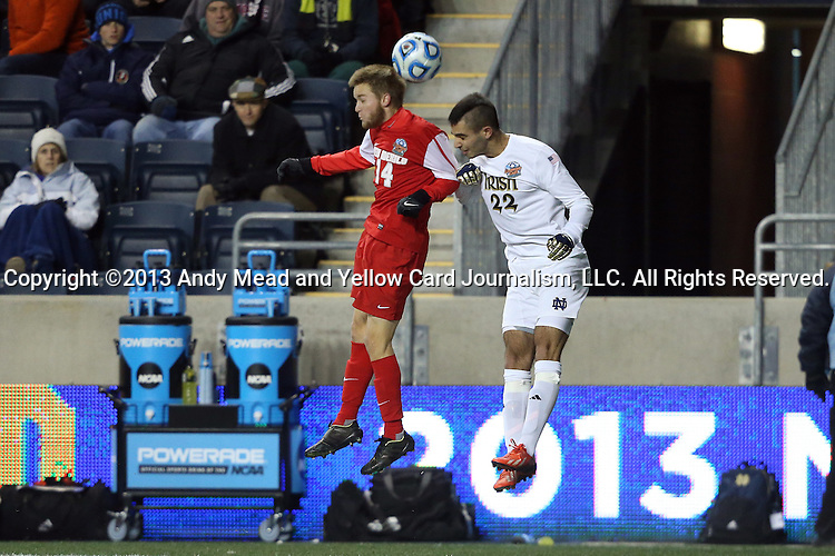 13 December 2013: New Mexico's Christopher Wehan (14) and Notre Dame's Luke Mishu (22). The University of Notre Dame Fighting Irish played the University of New Mexico Lobos at PPL Park in Chester, Pennsylvania in a 2013 NCAA Division I Men's College Cup semifinal match. Notre Dame won the game 2-0.