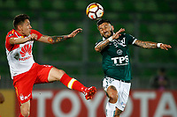 VALPARAISO - CHILE - 13 - 02 - 2018: Marco Medel (Der.) jugador de Santiago Wanderers disputa el balón con Sebastian Salazar (Izq.) jugador de Independiente Santa Fe, durante partido de ida entre Santiago Wanderers (CHL) y el Independiente Santa Fe (COL), de la fase 3 llave 1 por la Copa Conmebol Libertadores 2018, jugado en el estadio Bicentenario Elias Figueroa de la ciudad de Valparaiso. / Marco Medel (R) player of Santiago Wanderers vies for the ball with Sebastian Salazar (L) player of Independiente Santa Fe, during a match of the first leg between Santiago Wanderers (CHL) and Independiente Santa Fe (COL), of the 3rd phase key 1 for the Copa Conmebol Libertadores 2018 at the Bicentenario Elias Figueroa Stadium in Valparaiso City, Photo: VizzorImage / Andres Pina / Cont / Photosport